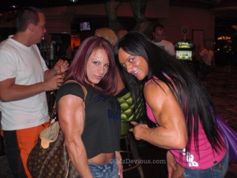 Mz Devious with Katka Kyptova biceps